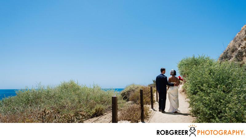 Couple Walking Up Path after Terranea Beach Wedding