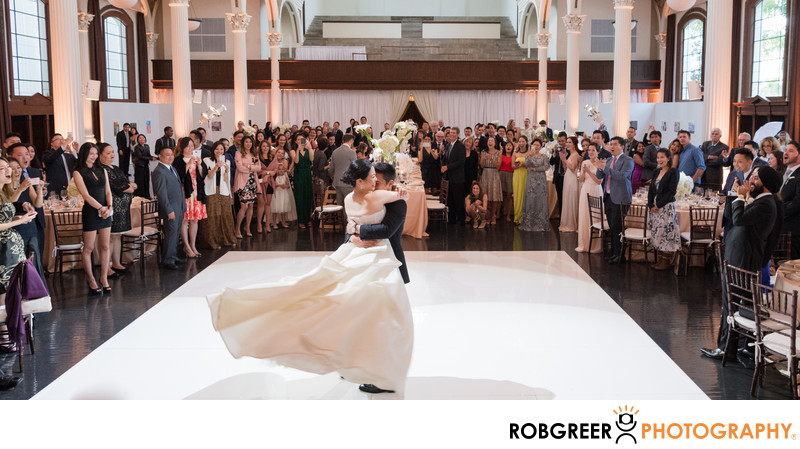 Groom Swings Bride Around During Vibiana Reception