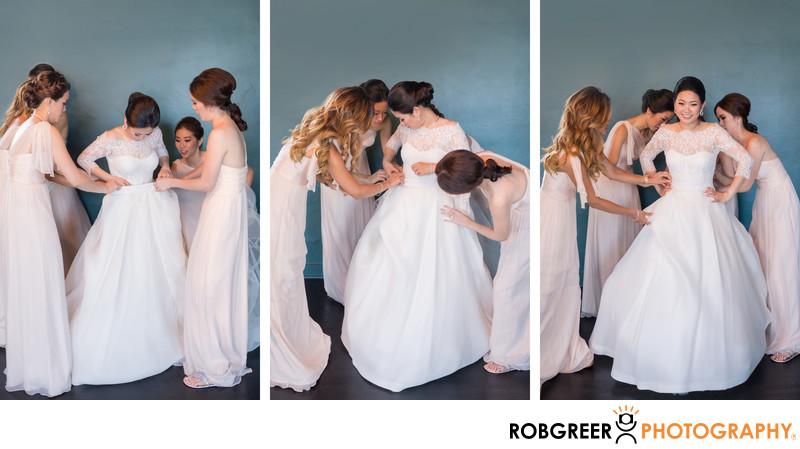 Bridesmaids Help Bride Get Dressed for Vibiana Wedding