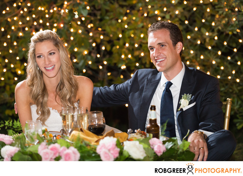 Couple Listens to Speeches During Wedding Reception