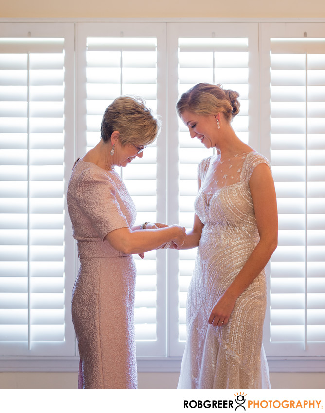 Mother Helps Bride with Bracelet before Loyola Wedding