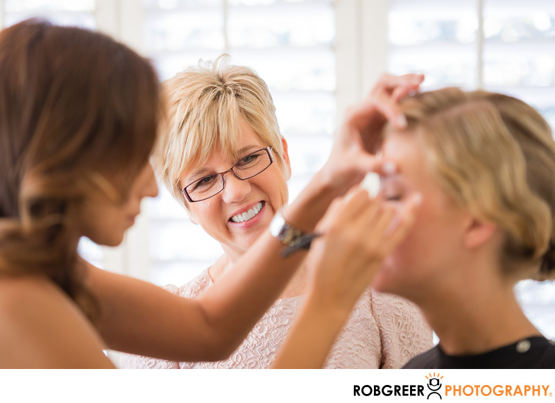 Mother of Bride Watches during Makeup Application