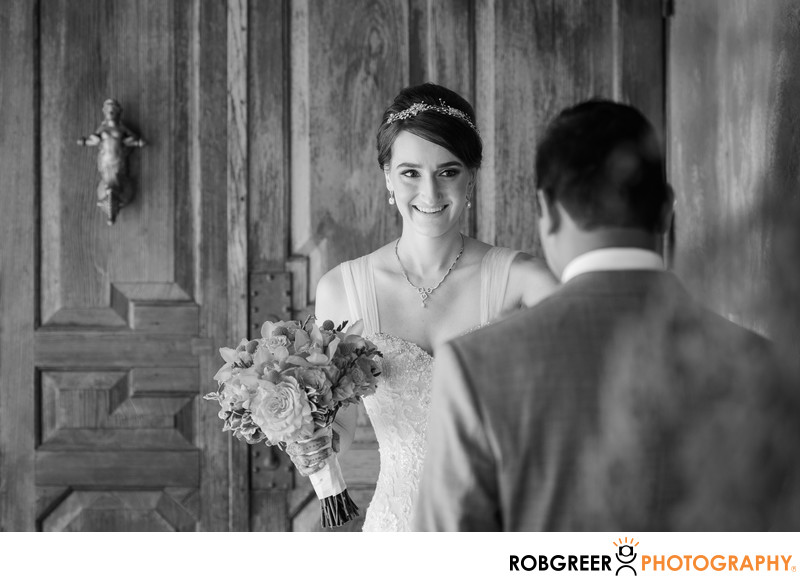 Bride Smiles at Groom after First Look