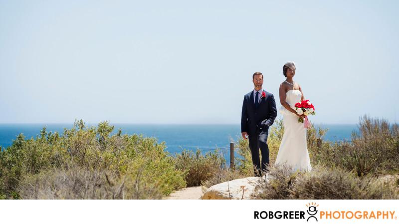 Bride & Groom Standing on Rob's Rock at Terranea Resort
