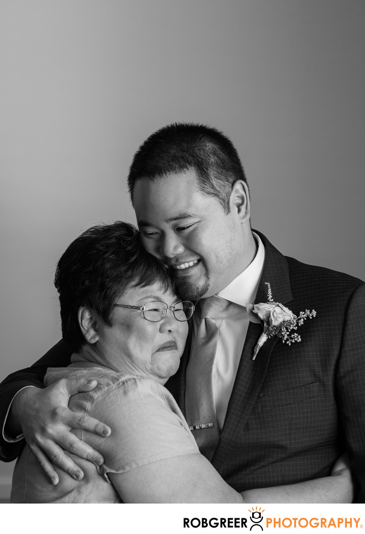 Groom Hugs Mother at Storrier-Stearns Japanese Garden