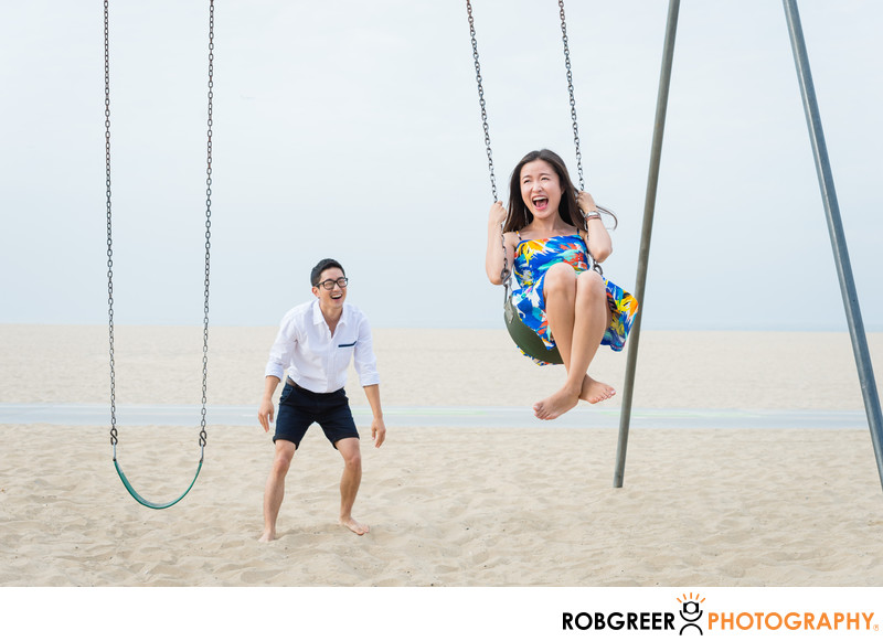 Fun Couple on Swings Near Santa Monica Pier