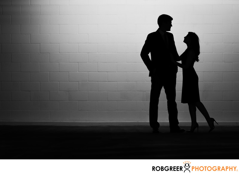 Silhouette Portrait of Engaged Couple in Parking Garage