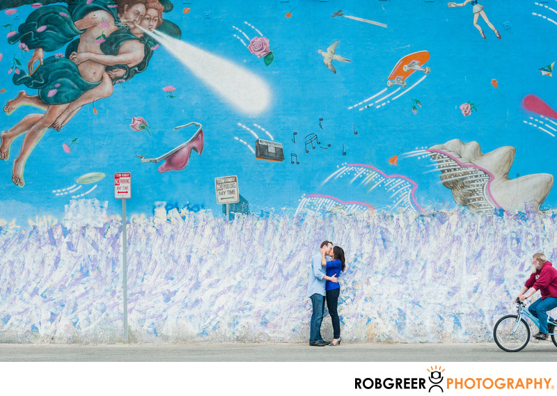 Venice Couple Under Famous Wall Mural of Angels