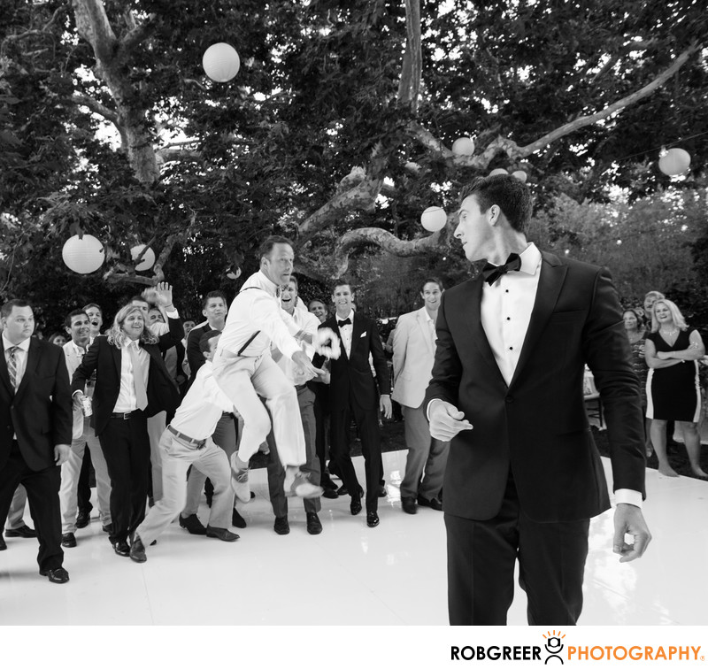Wedding Guest Leaps During Malibu Garter Toss
