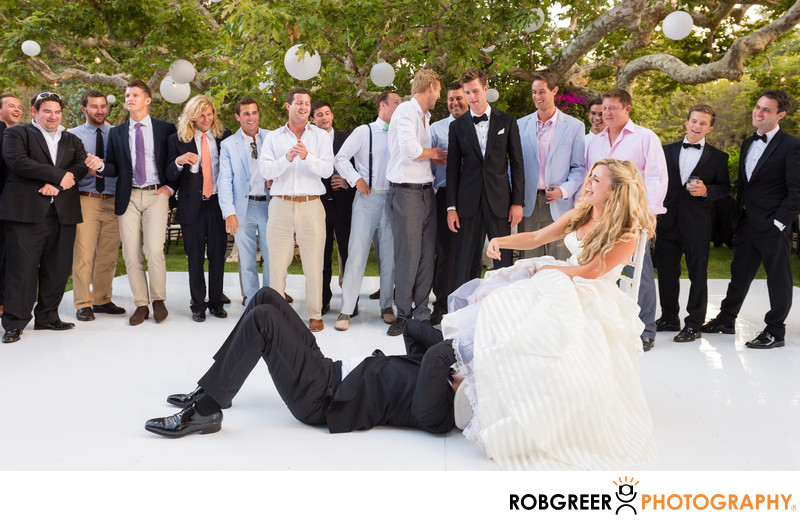 Groom Goes for the Garter during Wedding Reception
