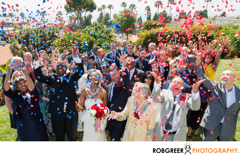 Wedding Guests Celebrate with Confetti after Ceremony