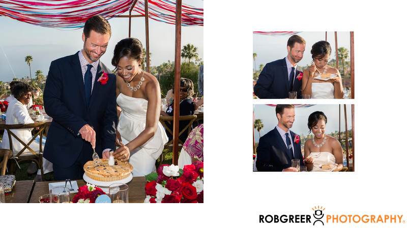 Couple Having Fun Cutting Pie at Wedding Reception