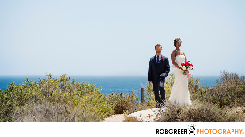 Bride & Groom Standing on Rob's Rock at Terranea Resort