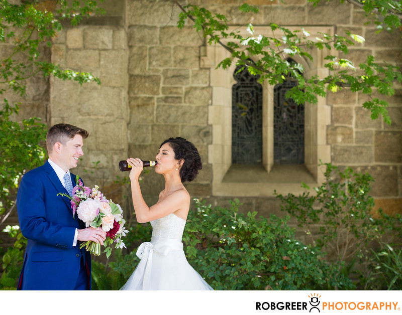 Bride Drinks Beer with Groom near All Saints Church