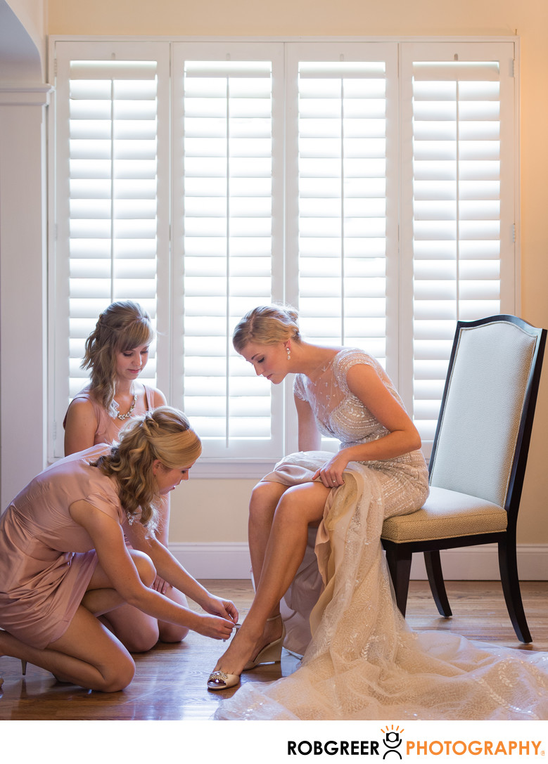 Bride's Sisters Help with Shoes as Bride Gets Ready