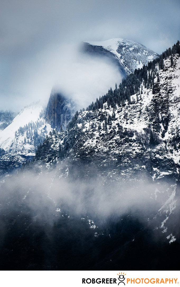 Yosemite's Snowy Half Dome Shrouded in Winter Clouds