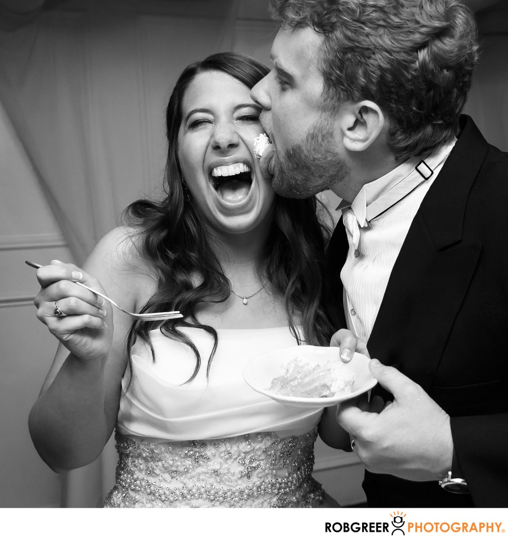 Groom Licks Wedding Cake Frosting