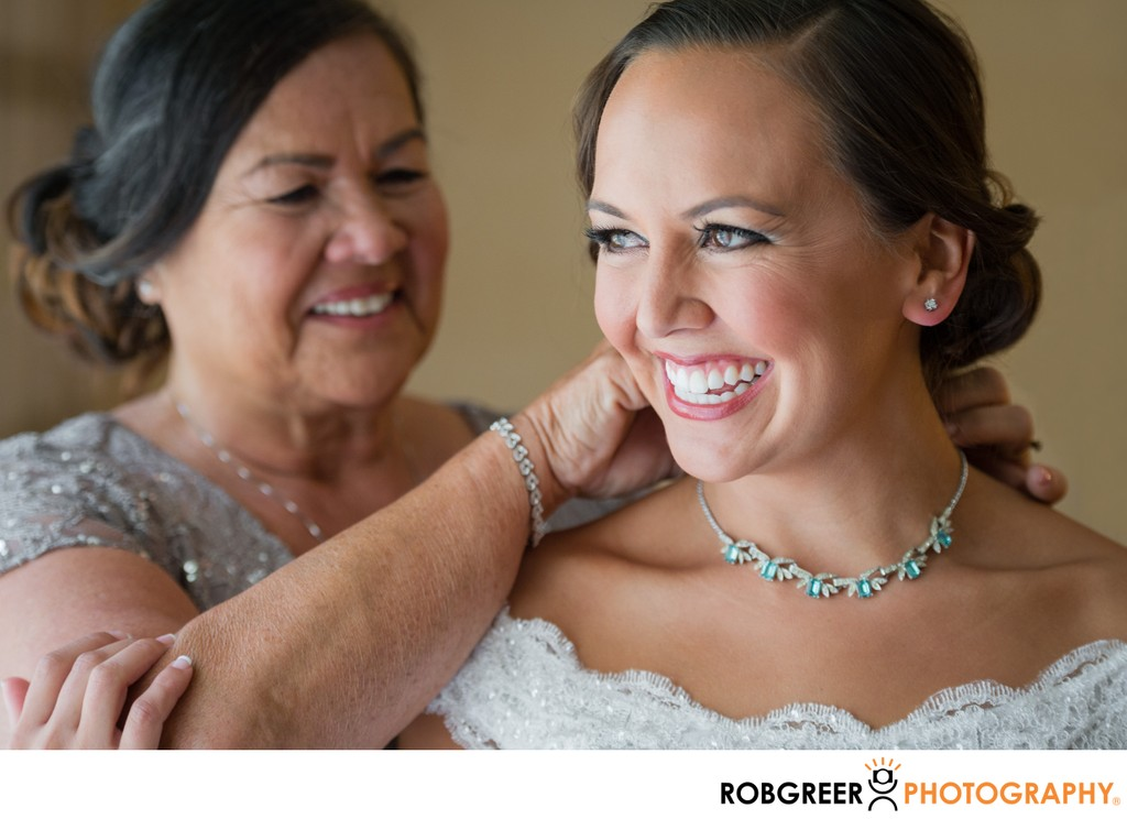 Getting Ready: Mother Fastens Bride's Necklace
