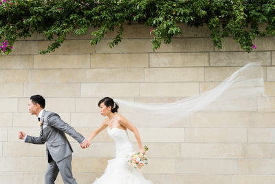 Groom and Bride Running with Veil Flying at Disney Hall