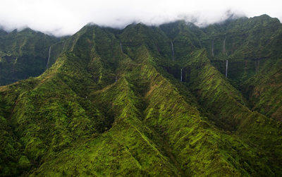 Aerial View of Cloud Topped Mountains & Waterfalls