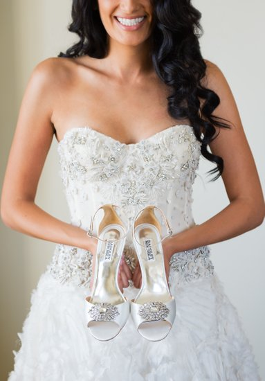 Getting Ready: Bride Holds Shoes