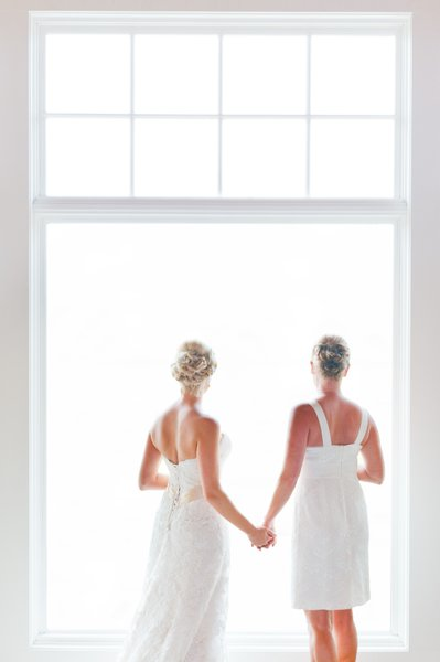 Brides Holding Hands: Gay Wedding