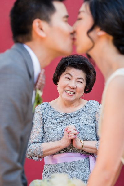 Mother of the Bride Watches Kiss